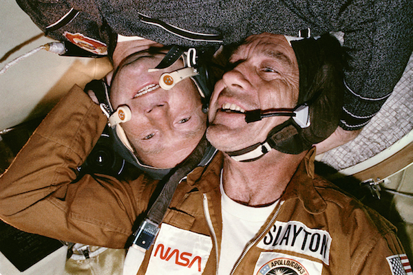 Deke Slayton with cosmonaut Alexey Leonov in the Soyuz spacecraft.